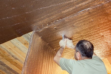 Insulation of the ceiling. builder strengthens the insulation to the ceiling. construction work