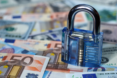 Lock on a background of money