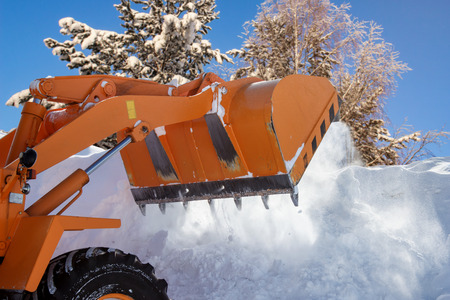 The bulldozer clears away snow drifts Stock Photo - 99431974