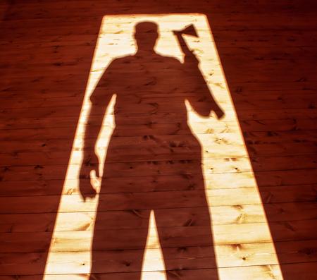 Shadow of murderer hand axe 版權商用圖片