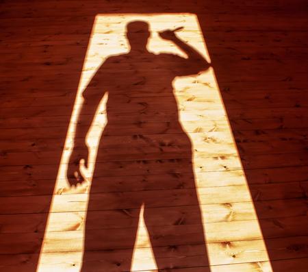 Man hand holding  knife in shadow 版權商用圖片