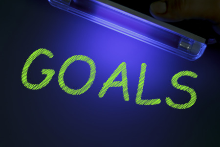 The word GOALS is manifested under the ultraviolet lamp in green