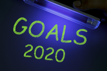 The word GOALS 2020 is manifested under the ultraviolet lamp in green