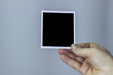 Woman showing a blank black photo