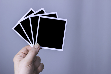 The woman holds in the hands of four black photo