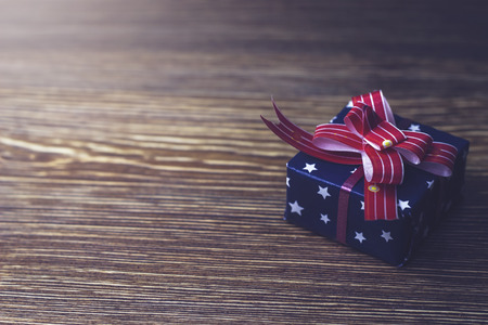Gift box Packed in black packaging with red ribbon