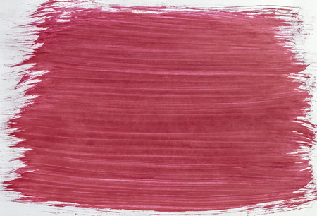 Plastered the sheet with a brush of light red paint 版權商用圖片