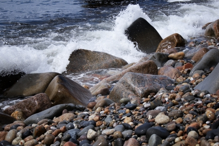 pebles: waves on the rocky shore of Rhode Island