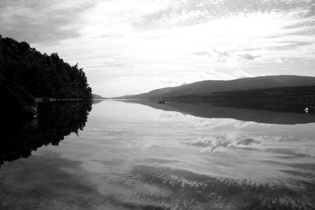 lochs: Big sky reflection in Scottish Loch. Stock Photo