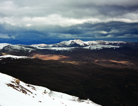 nevado: Panoramic landscape of Valle Nevado in Chile country, mountains, snow and a blue sky. Showing the beginning of winter on the eve of the opening of the ski center, Stock Photo