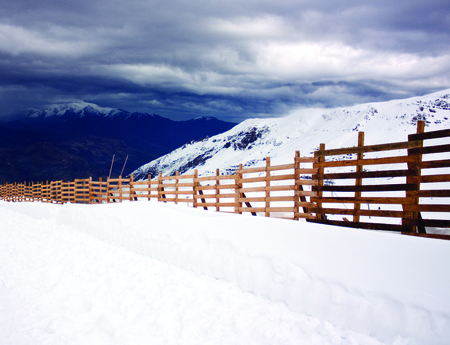 nevado: Majestic landscape at the beginning of the Chilean winter in Valle Nevado in Chile, contrasting the earths coffee and snow white Stock Photo