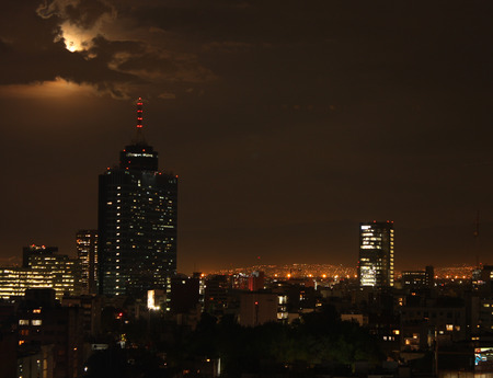 Blue blood moon in Mexico City with urban landscape the phenomenon is only lived every 150 years worldwide.