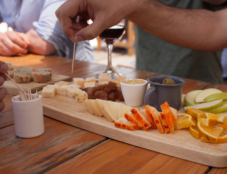 cheeses near me to try bread, wine, fruits, olives and honey