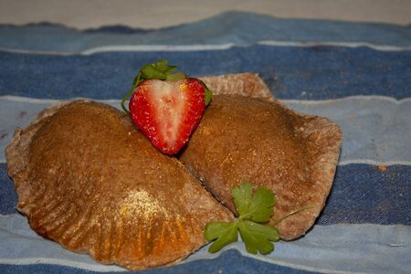Wholemeal sweet strawberry patties nuanced in gold