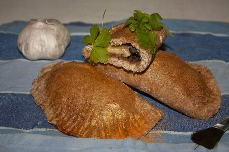 Fresh whole-grain and healthy salted patties stuffed with black delicacy, garlic and gold-matched strawberry parsley gourmet food