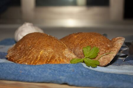 Fresh healthy whole-grain salted patties stuffed with garlic-flavored chicken and parsley nuanced with edible gold