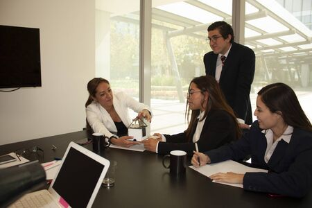 Successful businesswomen office workers reviewing the conceptual real estate mock-up of a house for construction in Mexico City