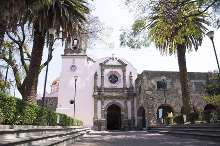 Stone church in Asunción neighborhood wrapped between cobbled streets and fruit and ornamental trees give life to the town