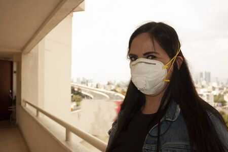 Mexican woman wearing a nurse or caregiver mouth cover for older adults in Mexico City