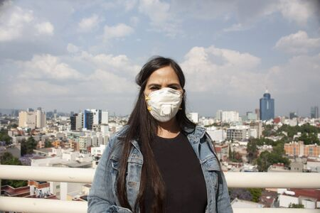 use mask covering nose and mouth for a Mexican woman sick with influenza, coronavirus, bacteria, long hair between 40 and 45 years in Mexico City