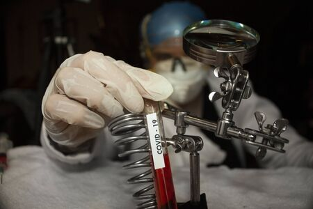 Scientist hand holding test tube with prototype plasma fluid for covid-19 vaccine in mexico city Reklamní fotografie