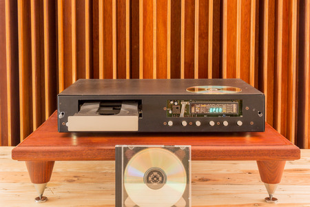 cd player: The old Cd Player beside wood background Stock Photo