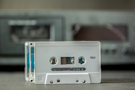 tape player: Old cassette tape beside blured cassette  tape player