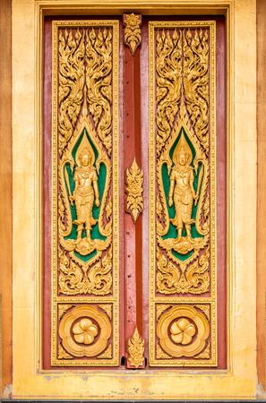 architech: Beautiful Thai art on carved woosd door Stock Photo