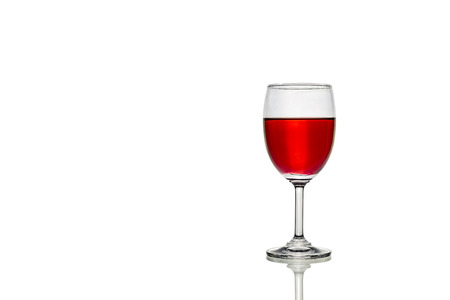 red water: A wineglass with red water in white background.
