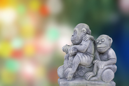 abstract gorilla: The monkey statue in blurred abstract background. Stock Photo