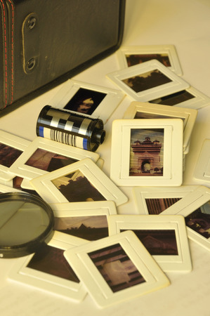 Pile of old film slides with plastic frames of asian art and culture memories in old vintage color style photo