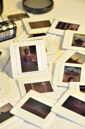 asian art: Pile of old film slides with plastic frames of asian art and culture memories in old vintage color style