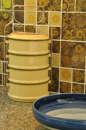 kitchen counter top: Food containers on asian kitchen counter top; tiffin and porcelain bowl