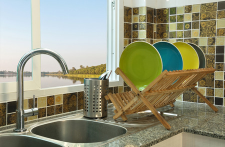 kitchen sink with wooden plate rack in asian kitchen style Stockfoto