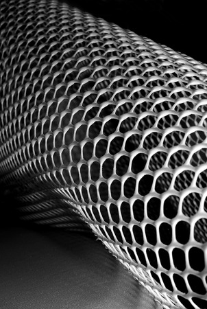 abstract monochrome image of plastic honeycomb mesh photo
