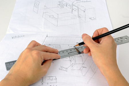 imagining: Hand is drawning  sketch of the kitchen with pencil and ruler Stock Photo