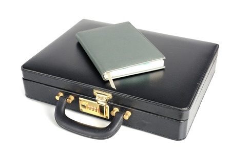 leather briefcase: black business leather Briefcase with book on white background Stock Photo