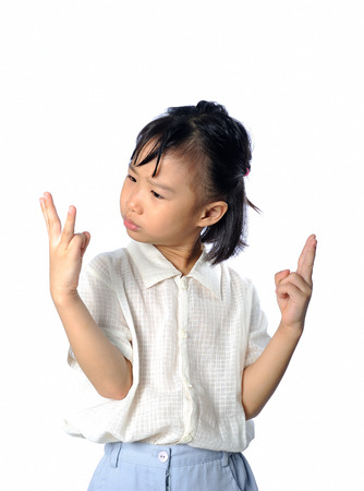 Confused little asian child do not know the answer - problem with mathematics Stock Photo
