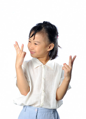 knowing: One happy asian child count number and  knowing the answer isolated in white background