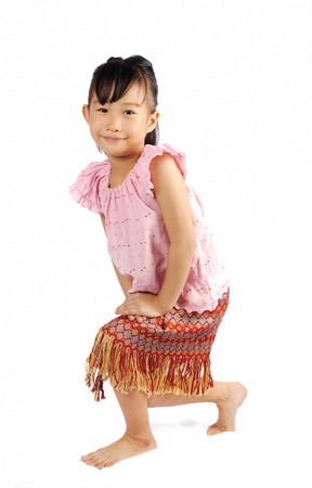 curtsy: asian little girl doing a curtsy in thai style