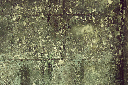 Old stain grunge decay wall with crumbling paint photo