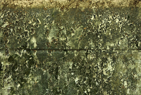 Old grunge decay wall with crumbling paint photo