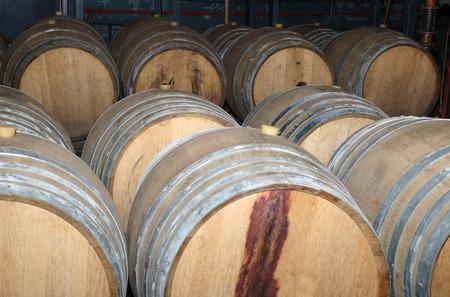 vats: wooden wine barrels in arrangement in a cellar Stock Photo