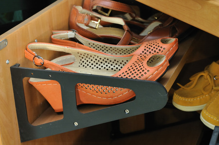 house ware: shoes on a wooden storage cabinet