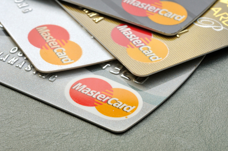 mastercard: BANGKOK,THAILAND - January 28,2015:  Mastercard credit cards on leather board.