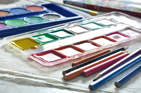 vibrant paintbrush: Box of mixed watercolors and set watercolors pallet