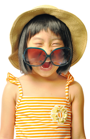 sunhat: happy asian little girl in swimsuit ,sunglasses and sun hat on white background