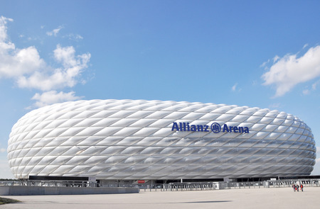 MUNICH, GERMANY - 12 APRIL 2016: Allianz Arena stadium in Munich, Germany. The Allianz Arena is home football stadium for FC Bayern Munich with a 69,901 seating capacity. Banco de Imagens - 71283611