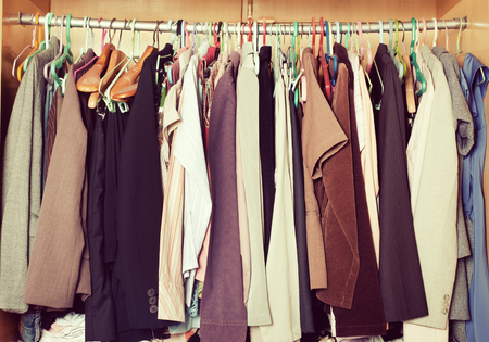 Pile Of Messy Clothes In Closet. Untidy Cluttered Woman Wardrobe In Vintage  Style. Stock