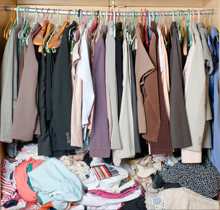 Pile Of Messy Clothes In Closet. Untidy Cluttered Woman Wardrobe. Stock  Photo   73950358